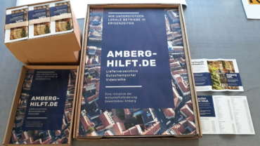 Plakat- & Flyerdruck für Amberg-hilft.de